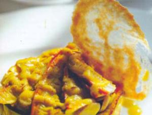 Receita de Salada de cogumelos sobre fritadinha de batata